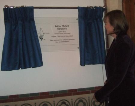Sophie Neville, who played titty in the feature film of 'Swallows & Amazons' (1974) unveiling a plaque to commemorate Arthur Ransome at Rugby School. It includes a copy of Arthur Ransome's sketch of the Amazon from his book 'Swallows and Amazons'