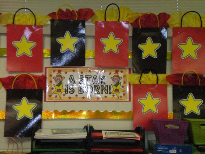 birthday bags...cute idea instead of a bulletin poster.  Put their names or tiny presents with their names on it to display