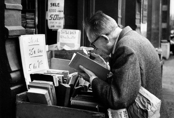 From what, to me, is one of Andre Kertesz's most beautiful little books, 'On Reading'. This is NYC, Man Reading with a MagnifyingGlass, 1959