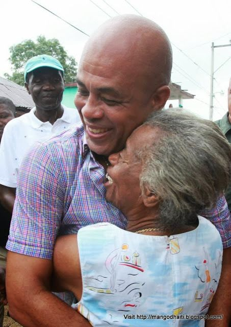GOVERNMENT: The current president of Haiti is Michel Martelly.  This picture shows Michel hugging a local Haitian. Presidents in Haiti have one five-year term. Also, in order to be president you need to be 35, and you had to have lived in Haiti for five years before the election. Haiti's government is a democracy, just like the U.S.