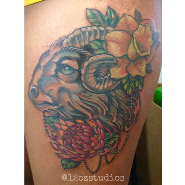 Aries zodiac themed female thigh tattoo with different for Flowers for aries woman