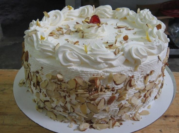 This cake I first tasted in a speciality Bakery, It is to Die For. I actually went back and bought a 2nd cake. ( My Hips really needed that 2nd cake ya know) Photo is from the bakery.I have since searched and Searched but could not Find a recipe for this Special Cake. Until I found a site from Italy. They say this is one of their Special celebration cakes, used for festivites, and celebrations.To Decorate this cake, Top with Whipped Cream piped Rosettes around the top, then Put a lot of…