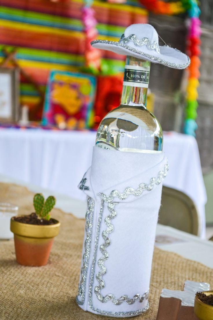 Fiesta decor. Charro dressed tequila bottles