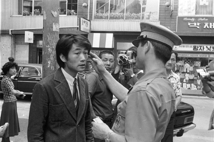 Seoul:  A policeman checks length of hair--scofflaws with long hair were taken to police station and given a quick haircut in the 1970's!
