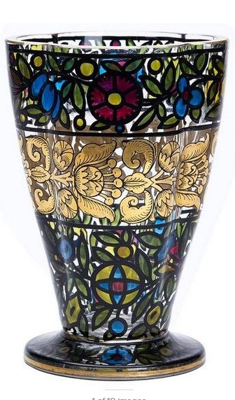 A superb Art Nouveau Bohemian art glass vase by Julius Mulhaus & Co, Haida. The thickly made shaped rounded glass vase is decorated in a stained glass window style with floral designs picked our in translucent colors within a black outline with an exquisitely black outline gilded floral design forming a central band. The vase has etched makers marks to the base.
