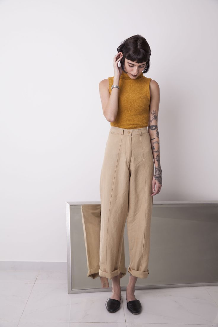 Casual summer style with high waisted pants and sleeveless mustard top #womensfashionclassic