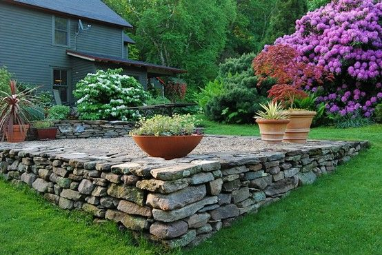 Landscaping Ideas For Uneven Yard : Stone patio for the uneven parts castle