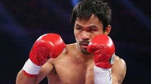 """This is Manny """"Pac-Man"""" Pacquiao. Pac-Man is a Eight-Division Boxing World Champion. Not only he is a boxing superstar, he also contributes to the nation. He does this by strengthening the Philippines economy . Many people either watch his fghts at home, or resturants. """"Whenever Philippines are happy, they spend money,"""" a local bartender says. Also, Pacquiao is one of the highest taxpayers in all of the Philippines. When Pac-Man is fighting, the economy rises for the Philippines."""