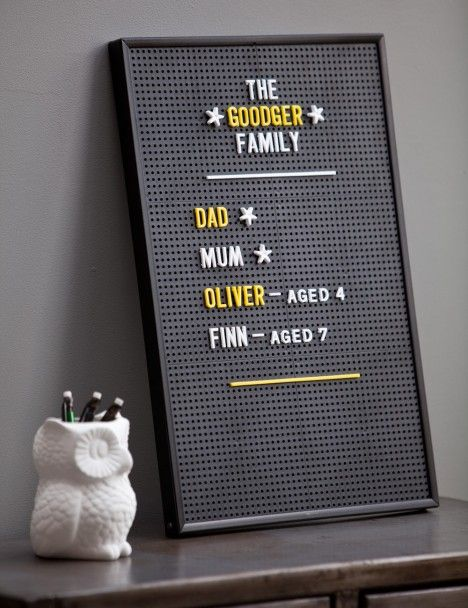 DIY family peg board. Could be great for a FHE board also.