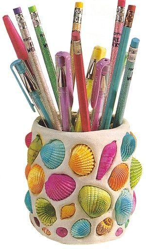 Collect sea shells this summer to create a colorful pencil holder.