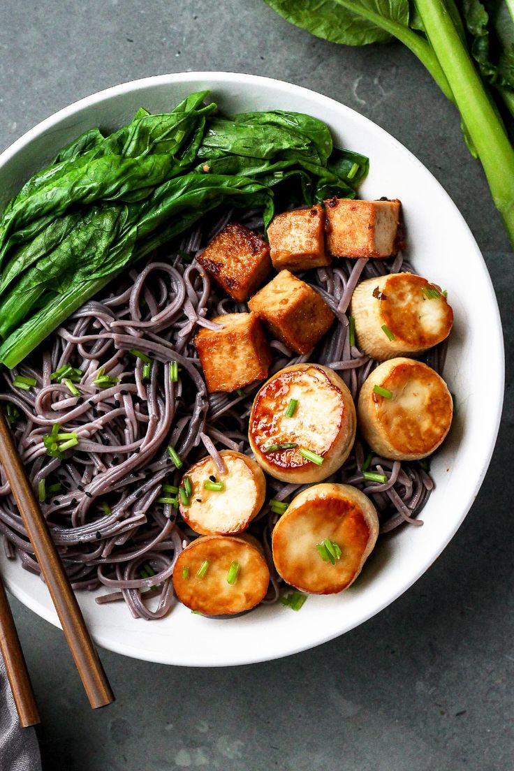 King Oyster Scallop Buddha Bowls - sautéed king oyster mushrooms, spicy peanut tofu, steamed baby bok choy and soba noodles flavored with a drizzle of sesame oil and chives.