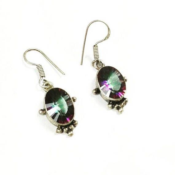 Vintage Mystic Rainbow Topaz Earrings In Bali Sterling Silver, November Birthstone, From NorthCoastCottage Jewelry Design & Vintage. Two beautifully matched rainbow mystic topaz are here set in a Bali style in sterling silver over copper. Absolutely lovely and unique, c. 1970s The