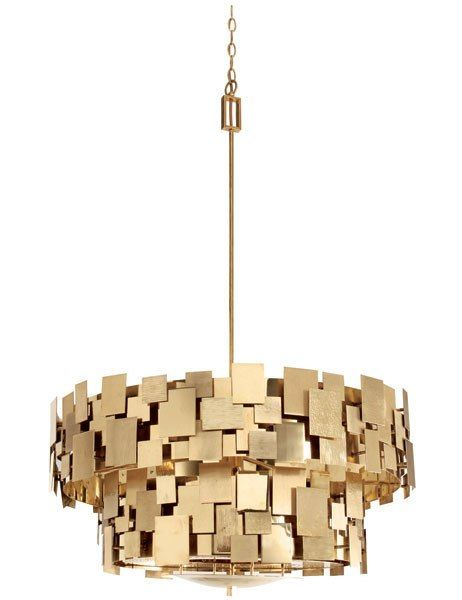 PORTA ROMANA The constellation of brass plates encircling Porta Romana's Luca ceiling lamp creates a stunning play of shadow and light.