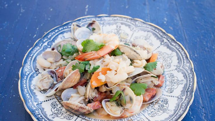An authentic Portuguese style meal, flavoured with clams, prawns and smoky sausage.