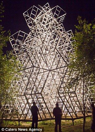 Archstoyanie Contemporary Art Fest 2012: Boris Bernaskoni erected a giant triumphal arch on the border between the forest and an empty field. The arch walls contain thousands of small traps for sunlight coming through slats in the wood and the roof accommodates a viewing platform. http://www.dailymail.co.uk/news/article-2241831/The-worlds-longest-trampoline-Russian-art-exhibition-hosts-170ft-long-bouncing-runway-built-middle-forest.html?ito=feeds-newsxml