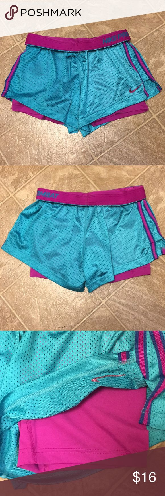 Nike Athletic Shorts Turquoise shorts with built in purple spandex short underneath. Excellent condition Nike Shorts