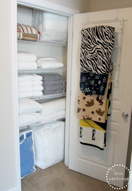 Over the door towel rack for all of the kid's fleece blankets. Perfect!