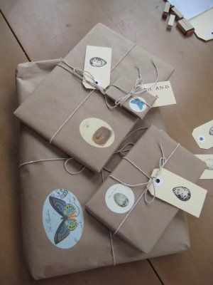 Brown paper parcels, string, postal tags and illustrations