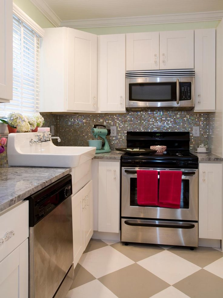 HGTV's Property Brothers added a little sparkle to this country kitchen with an iridescent backsplash. A fashionable apron-front sink, shaker-style cabinets and new stainless steel appliances complete the dazzling remodel.