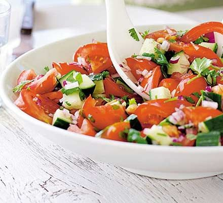 Tomato, cucumber & coriander salad. Great with Indian food or other spicy dishes.