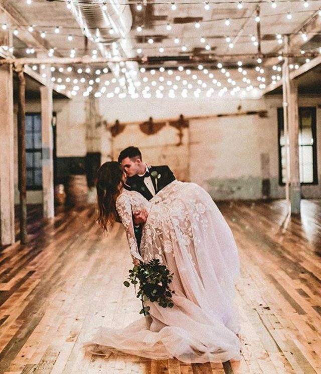 Industrial/contemporary wedding decor - stunning beige laced & floral wedding dress