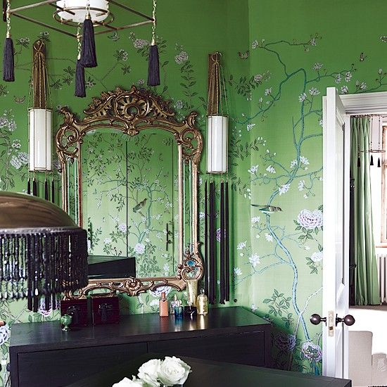 Vivid green bedroom wallpaper by de Gournay