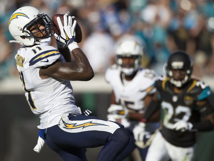 San Diego Chargers wide receiver Stevie Johnson, left, catches the ball in the third quarter against the Jacksonville Jaguars at EverBank Field. The San Diego Chargers won 31-25.   Logan Bowles, USA TODAY Sports