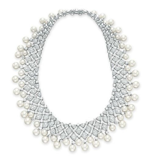 A CULTURED PEARL AND DIAMOND NECKLACE, BY OSCAR HEYMAN & BROTHERS Suspending a graduated fringe of cultured pearls, to the circular-cut diamond openwork neckchain, mounted in white gold, 13 ins., in a Oscar Heyman black velvet case With maker's mark for Oscar Heyman & Brothers, no. 504889