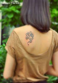 exquisite tribal flower tattoo design under the shoulder