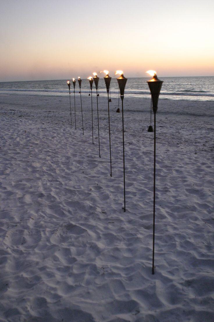 Beach Wedding - Tiki torches at sunset