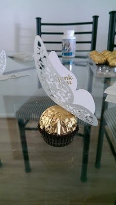 Ferrero Rocher wedding favor, wedding favour, wedding bomboniere, butterfly via http://themummanextdoor.blogspot.com.au/2015/10/our-vintage-country-wedding.html