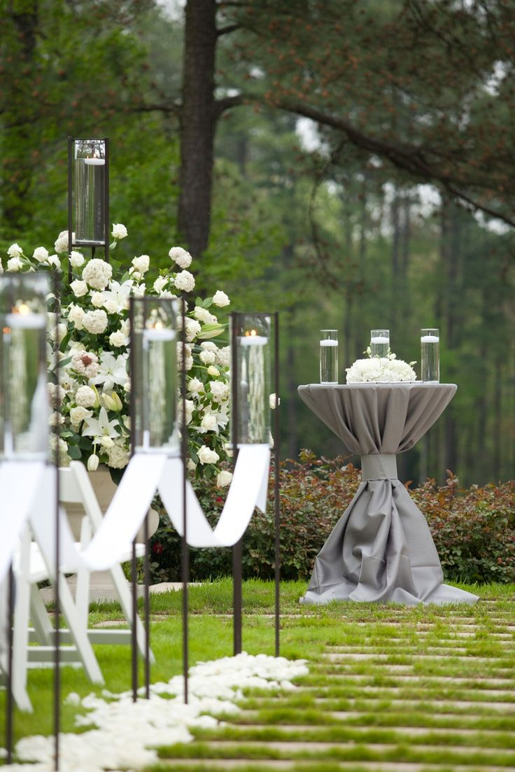 Beautiful outdoor wedding ceremony setup by Watered Garden- love the table decor..would be neat in burlap in a more casual wedding...