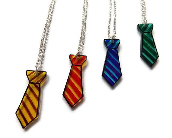 Harry Potter House Necklaces: Hufflepuff (yellow) Loyal; Gryffindor (red) Brave; Ravenclaw (blue) Wise; Slytherin (green) Evil [Cunning]