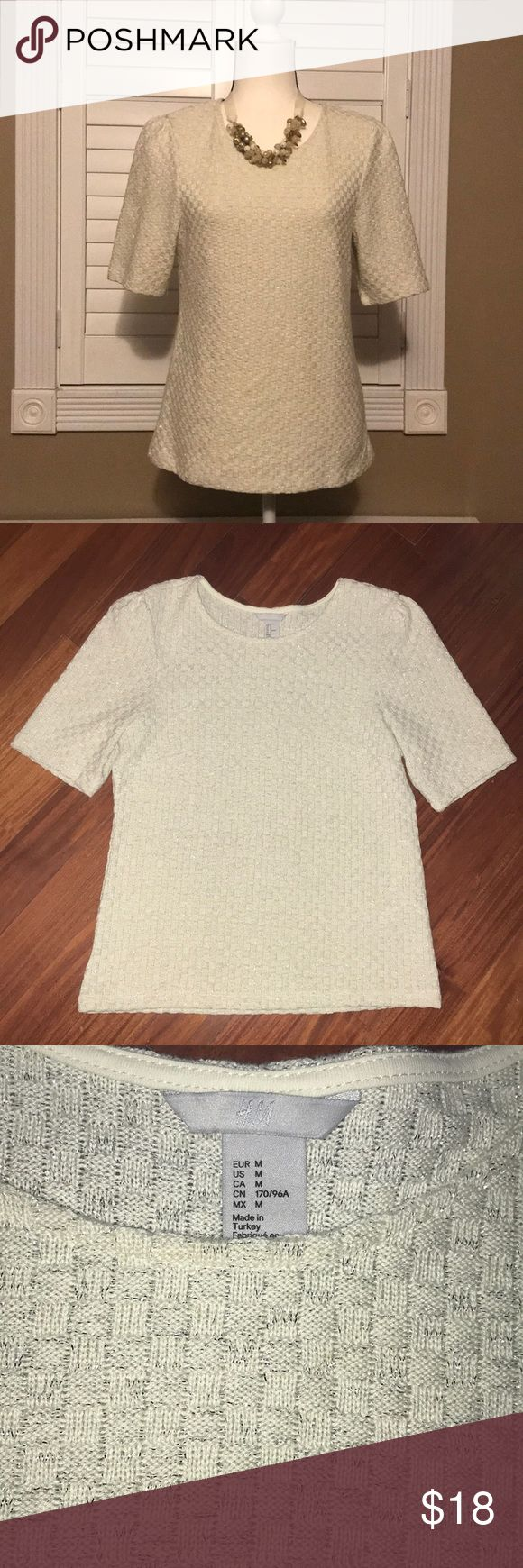 """H&M princess 3/4 sleeve metallic knit woven top Preowned. Worn once, mint condition. H&M. 3/4 princess puff sleeve cream ivory silver metallic knit woven shirt top women's size medium. Approx measurements bust 18"""" and length 24"""". H&M Tops Tees - Short Sleeve"""