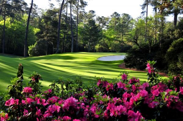 Augusta National Golf Club.- we saw them clipping around the bunkers with scissors! Unbelievably manicured...