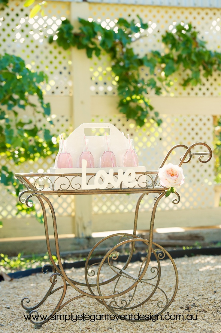How about our vintage drinks cart for your garden ceremony! Cute and easy to push around it looks great with lots of drinks on top!