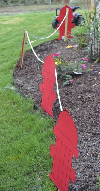 Firetruck Party decoration. I would add a backside to the hydrant and cover the stakes.