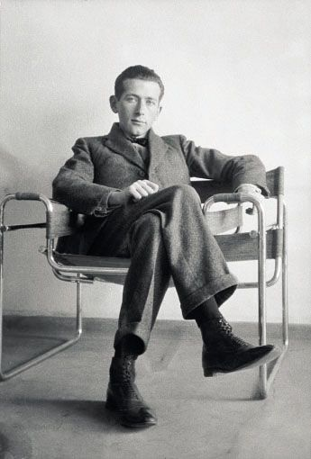 Hungarian-born modernist, architect and furniture designer, Marcel Breuer( 1902-1981) in one of his Wassily chairs. Was the pioneer of tubular steel furniture, which was allegedly inspired by his bycycle handlebars.