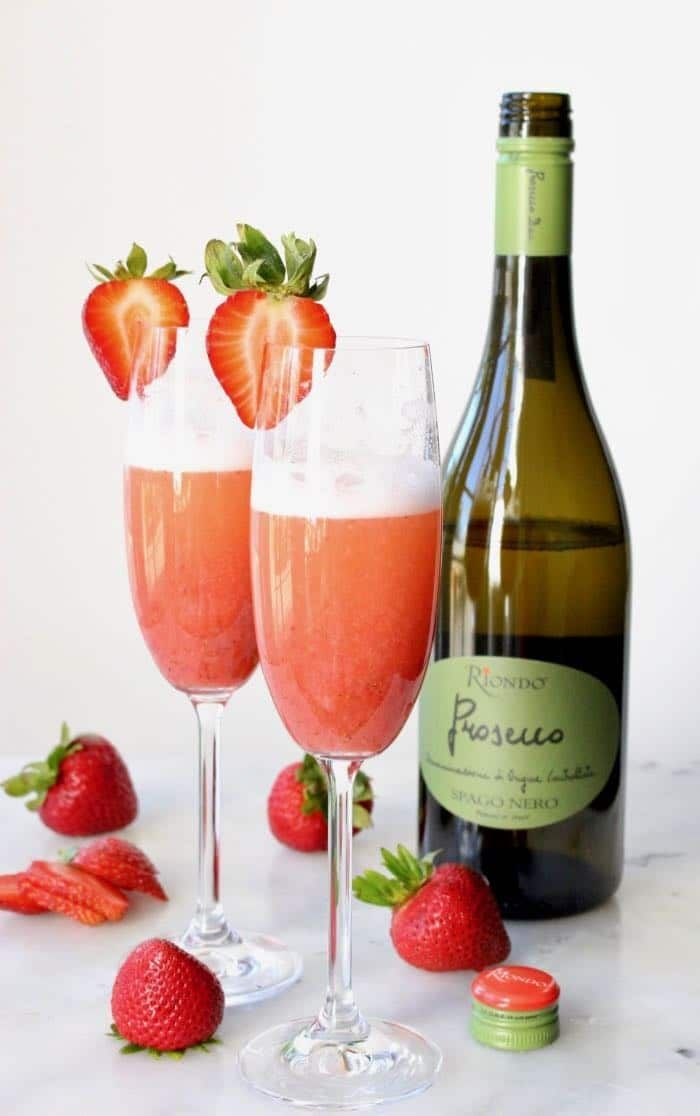 Italian Strawberry Bellini Cocktails with bubbly Prosecco white wine, honey strawberry syrup or puree, plus an exotic touch of vanilla.