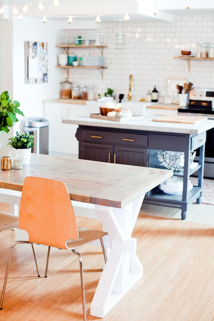 A DIY Farmhouse Table for Kitchen or Dining for under $100. See the full farmhouse table tutorial!