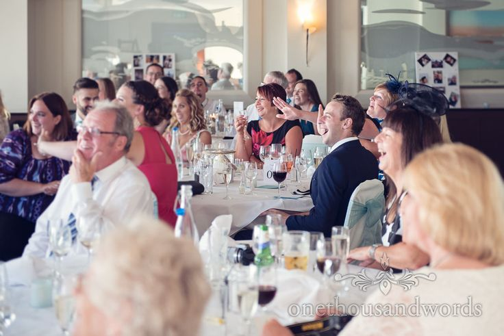 Seated guests react to best man speech at Harbour Heights wedding. Photography by one thousand words wedding photographers