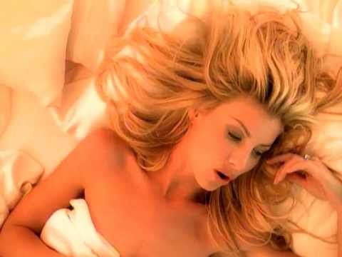 """Faith Hill - """"Breathe"""" (Official Video) Country singer Faith Hill leaned heavily in a pop direction here. Although the song didn't climb higher than #2 on the Billboard Hot 100 it spent over a year on the chart and was named the top pop chart single of the year. It is a classic power ballad that also spent 17 weeks at #1 on the adult contemporary chart."""