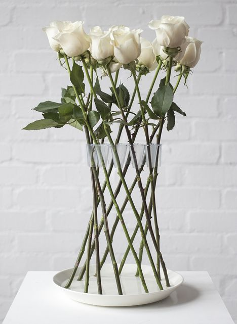 The Crown Vase is a circular flower holder that arranges rigid-stemmed flowers into a beautiful free-standing structure.