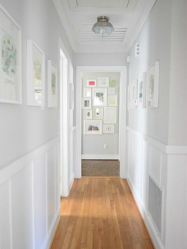 A fresh bright, light and airy hallay. Love the art on the walls and the gallery at the end of the hallway to draw your eye forward.