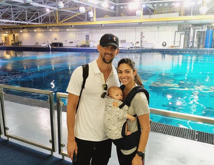 Michael Phelps and fiancé, Nicole Johnson, are a babywearing family! With their son, Boomer Phelps, in our Baby Tula Navigator print carrier.