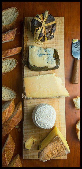 Little Big Apple bloomy rind, Rogue Creamery Rogue River Blue, Cabot Creamery cheddar, Coupole bloomy rind and Murray's Sandy Relief Comté - via Ruud Walthaus