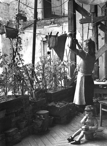 Woman hanging out washing, 1946  It's not a balcony - the courtyard wall of her apartment has been totally destroyed.History, Courtyards Wall, Vintage Photographers, Domestic Divas, Clotheslines Art, Classic Photos, Totally Destroyer, Laundry, Woman Hanging