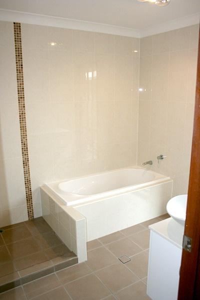 Bathroom Renovations Brisbane - White Bath, Brown bathroom tiles