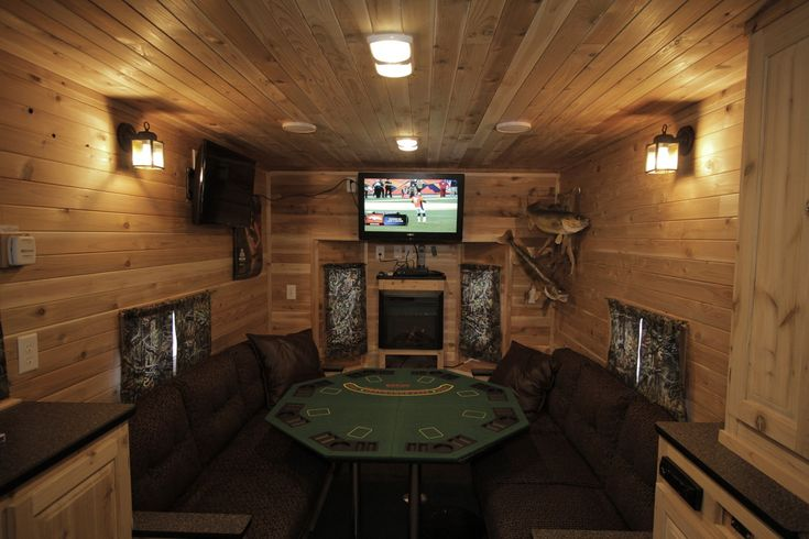 A poker table, a pair of mounted walleyes, and a big-screen TV in Mr. Larson's Ice Castle fish house.