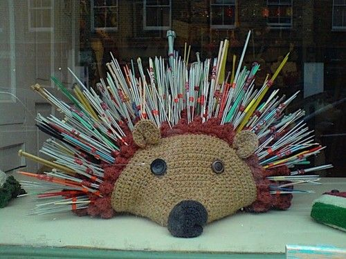 Hedgehog knitting needle holder     I like the idea of this, but I'd lose every needle in it to the same cat who steals pins, hair ties, and writing implements